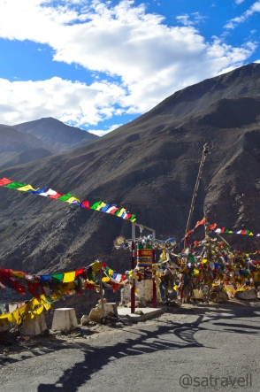 Prayer Flags, Wheels and a small shrine on the road