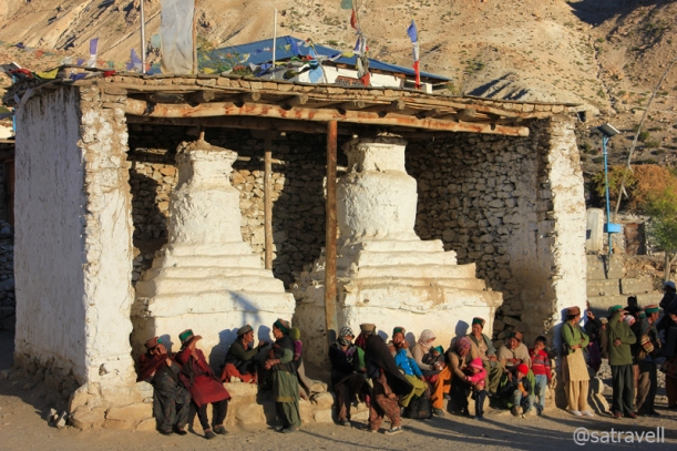 Villagers assembled alongside ancient Chortens, part of the tenth-century Sacred Compound, to watch the proceedings