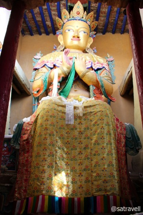 The 13.7m high gold-coloured statue of Maitreya Buddha inside the Gompa