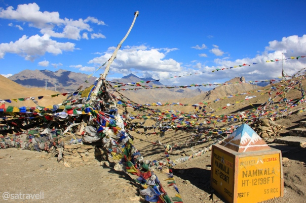 Fluttering prayer flags atop the Namika La