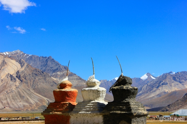 Entrance to Rangdum Valley by tri-colour chortens; the tri-colour – Black, White, Red (Ochre) – on chortens in trans-Himalayas symbolize a worldview – underworld, sky, earth – much older than Buddhism itself.