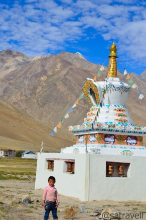 A Tibetan chorten at Sani; Also a kid (desperately wanted me to take his photo) in the foreground