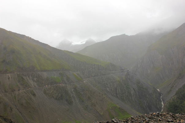 Notice the traffic jam on the lower road; Machoi Glacier enveloped in clouds