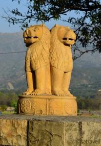 Ashoka Pillars guarding the entrance
