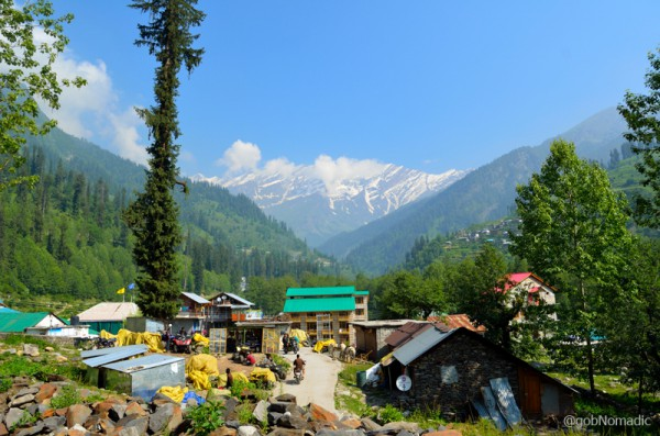 The snowy heights of Pirpanjal and the developing settlement at Solang.
