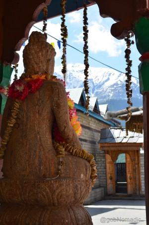 A recently installed statue of Buddha overlooks the Kamakhya Temple courtyard at Kamru