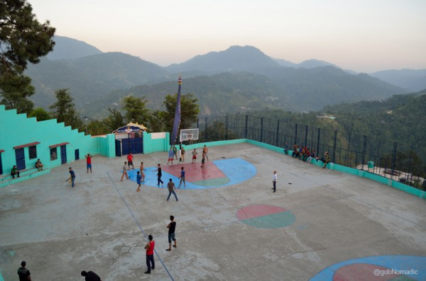 Younger monks and children at the playground