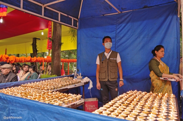 Votive metalled butter-lamps at the venue