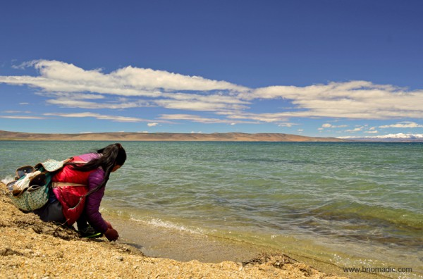 A Tibetan pilgrim collecting pebbles