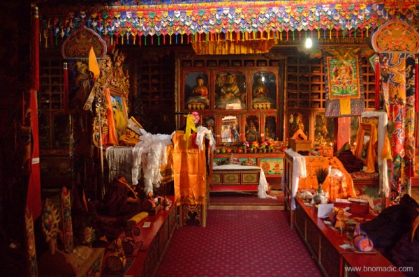 The central three figures in the ornate dukhang are Dusum Sangye, the Buddhas of the Three Times. Many of the small statues here were originally at Shepeling.