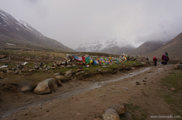 Just before Deraphuk; prayer flags festooned around rocks indicate a sacred shrine on the Kora