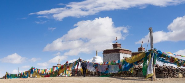 """Darchen - Chiu Monastery - Manasarovar Lake - Tibetan Plateau - Tibet Autonomous Region - China With jeep on the road. Chiu Gompa Monastery or Ji'wu temple in Western Tibet: It is located a short distance from the small town of Darchen at the base of Mt. Kailash. It is about a 900 km drive from Lhasa and usually takes about four days. Western Tibet is remote, rugged, windy, and cold. It is much more rural than Central and Eastern Tibet. The people of this rugged area dress in long thick robes to protect themselves from the constant wind and cold. The woman all wear the distinctive fuchsia scarves around their heads. http://intothemiddlekingdom.com/2012/09/16/chiu-gompa-monastery-in-western-tibet/ We pass: Lake Manasarovar is a freshwater lake in the Tibet 940 kilometres from Lhasa. To the west of it is Lake Rakshastal; to the north is Mount Kailash. https://en.wikipedia.org/wiki/Lake_Manasarovar The Tibetan Plateau, is a vast elevated plateau in Central Asia or East Asia, covering most of the Tibet Autonomous Region and Qinghai Province in western China, as well as part of Ladakh in Jammu and Kashmir state of India. It stretches approximately 1,000 kilometres north to south and 2,500 kilometres east to west. With an average elevation exceeding 4,500 metres , the Tibetan Plateau is sometimes called """"the Roof of the World"""" and is the world's highest and largest plateau, with an area of 2,500,000 square kilometres (about five times the size of Metropolitan France). Sometimes termed the """"Third Pole"""", the Tibetan Plateau is the headwaters of the drainage basins of most of the streams in surrounding regions. Its tens of thousands of glaciers and other geographical and ecological features serve as a """"water tower"""" storing water and maintaining flow. The impact of global warming on the Tibetan Plateau is of intense scientific interest. https://en.wikipedia.org/wiki/Tibetan_Plateau"""