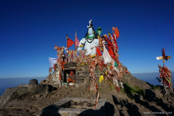 Above a compilation of rocks and slates, a statue of Lord Shiva adds the required five feet to make it a 12,000 ft peak.